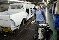 This file photo shows an employee of Ssangyong Motor work on the factory line at the Ssangyong plant in Pyeongtaek, 70 km south of Seoul. South Korea's overall unemployment rate fell to its lowest level in more than five years in October, despite a rise in the number of young people out of work, according to official figures
