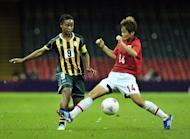 South Africa's midfielder Amanda Dlamini (L) fights for the ball with Japan's midfielder Asuna Tanaka during the London 2012 Olympic Games women's football match between Japan women and South Africa women at the Millennium Stadium in Cardiff, Wales. World champions Japan advanced into the quarter-finals of the Olympic women's football tournament after a goalless draw with South Africa