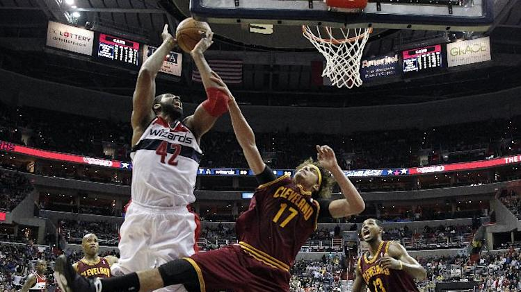 Washington Wizards forward Nene (42), from Brazil, is fouled by Cleveland Cavaliers center Anderson Varejao (17), also from Brazil, in the second period of an NBA basketball game on Saturday, Nov. 16, 2013, in Washington. The Cavaliers won 103-96 in overtime