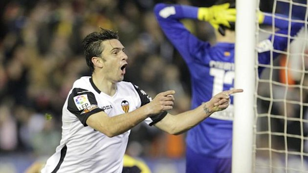 Valencia's Helder Postiga celebrates after he scored against Atletico Madrid during their Spanish King's Cup soccer match at the Mestalla stadium in Valencia, January 7, 2014 (Reuters)