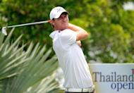 Chris Wood of England plays a shot during round three of the Thailand Open at the Suwan golf and country club on the outskirts of Bangkok. Wood was on course to spoil a fairytale ending for the home favourites after snatching a one-shot lead after the third round of the $1-million Thailand Open