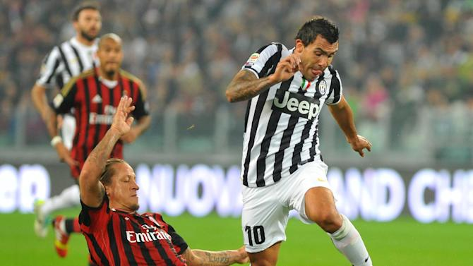 Juventus forward Carlos Tevez, of Argentina, right,  dribbles past AC Milan defender Philippe Mexes, of France, during a Serie A soccer match between Juventus and AC Milan at the Juventus stadium, in Turin, Italy, Sunday, Oct. 6, 2013
