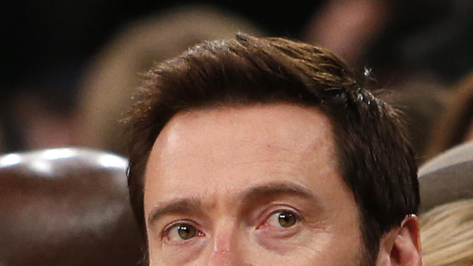 Actor Hugh Jackman attends an NBA basketball game between the Miami Heat and the New York Knicks Saturday, Feb. 1, 2014, in New York. Miami won 106-91. (AP Photo/Jason DeCrow)