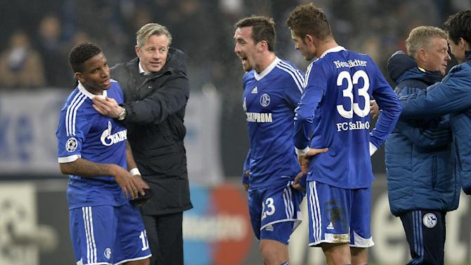 Schalke's Jefferson Farfan, head coach Jens Keller, Christian Fuchs and Roman Neustaedter, from left, joke after the Champions League Group E soccer match between FC Schalke 04 and FC Basel in Gelsenkirchen, Germany, Wednesday, Dec. 11, 2013. Schalke defeated Basel by 2-0