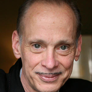 FILE - In this April 21, 2008 file photo, writer and director John Waters poses for a portrait at his home in New York. Waters will give the commencement address at Rhode Island School of Design on Saturday, May 30, 2015, and will receive an honorary Doctor of Fine Arts degree from the school. (AP Photo/Kathy Willens, File)