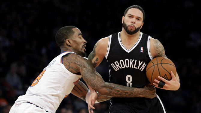 New York Knicks' J.R. Smith, left, fouls Brooklyn Nets' Deron Williams during the second half of the NBA basketball game at Madison Square Garden, Monday, Jan. 20, 2014, in New York. The Nets defeated the Knicks 103-80