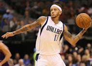 Delonte West of the Dallas Mavericks passes the ball against the Phoenix Suns during a preseason game on October 17, 2012. Three years ago, West, who was playing for Cleveland at the time, was riding a motorcycle when he was pulled over by police. They found a 9mm handgun in his waistband, a .357 Magnum revolver strapped to his leg and a shotgun hidden in a guitar case slung over his shoulder