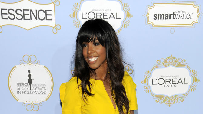 Singer Kelly Rowland arrives at the 6th Annual Black Women in Hollywood Luncheon at the Beverly Hills Hotel on Thursday, Feb. 21, 2013 in Los Angeles. (Photo by Chris Pizzello/Invision/AP)