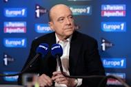 Founder of the French opposition right-wing UMP party, Alain Juppe, answers journalists' questions on November 25. Ex-president Nicolas Sarkozy on Monday waded in to a bitter leadership battle that has left France's main right-wing opposition party, the UMP, on the verge of collapse.