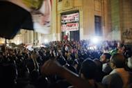 "Thousands of supporters of Egyptian President Mohammed Morsi celebrate in front of the Egyptian High Court in Cairo. Morsi assumed sweeping powers on Thursday, drawing criticism he was seeking to be a ""new pharoah"" and raising questions about the gains of last year's uprising to oust Hosni Mubarak"