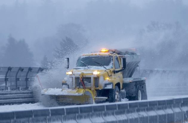 A snow plow clears the road of snow along the New York State Thruway Interstate 87 in Tarrytown