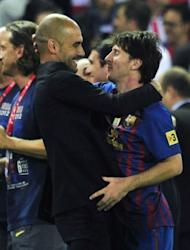 Barcelona's coach Josep Guardiola (L) embraces Barcelona's forward Lionel Messi at the end of the Spanish King's Cup final. Barcelona gave Guardiola the perfect send off Friday, beating Athletic Bilbao 3-0 in Madrid to win the Spanish Cup in the coach's last match in charge after a memorable four seasons in the Catalan hot seat