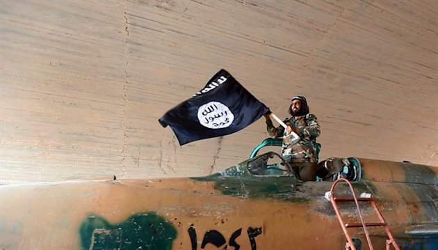This undated image posted on Aug. 27, 2014 by the Islamic State group shows a fighter of ISIS. (AP)