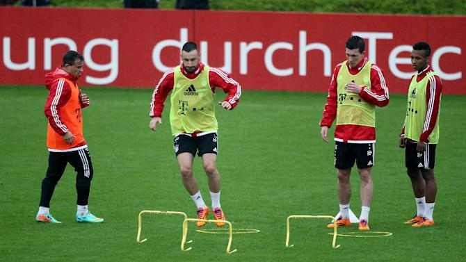 Players exercise during a Bayern Munich training session at the ASPIRE Academy for Sports Excellence in Doha, Qatar, Saturday, Jan. 11, 2014