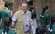 This file photo shows the founder of The Humla Children's Home charity, Eugene Lane-Spollen, interacting with Humla children at his home in Kathmandu