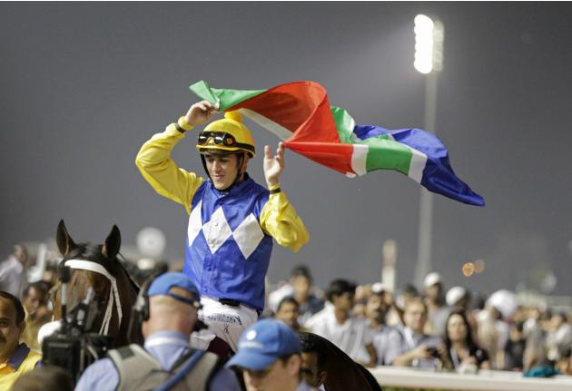"""Soumillon, riding Shea Shea of South Africa, celebrates after winning the fifth race """"Al Quoz Sprint"""" during the Dubai World Cup at the Meydan Racecourse in Dubai"""