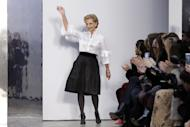 Carolina Herrera acknowledges audience applause after her collection was modeled during Fashion Week in New York, Monday, Feb. 13, 2017. (AP Photo/Richard Drew)
