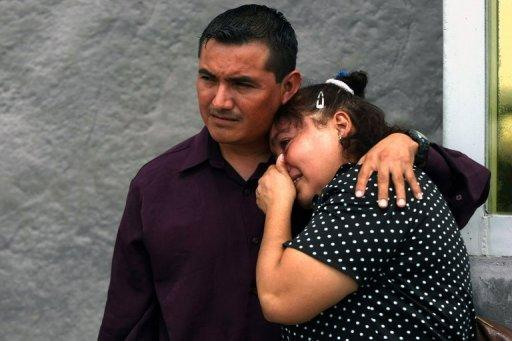 Relatives of victims of a fire in the gas plant of Mexican energy giant PEMEX cry outside the General Attorney's office in Reynosa, Mexico. The death toll from the fire rose to 29 while three workers remained missing Wednesday as witnesses recounted the terrifying blast and the inferno's intense heat.