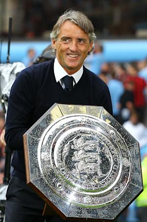 Roberto Mancini, pictured, has revealed that Micah Richards could be out for a month