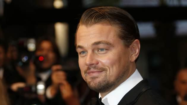 Leonardo DiCaprio smiles on May 15, 2013 as he arrives for the screening of the film 'The Great Gatsby' ahead of the opening of the 66th edition of the Cannes Film Festival in Cannes -- Getty Premium