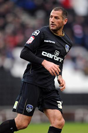 Shefki Kuqi will not be at Boundary Park next season as Oldham cannot afford his wages