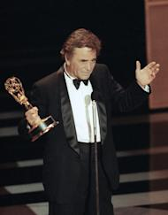 "FILE - In this Sept. 16, 1990 file photo, actor Peter Falk gestures as he accepts his the Emmy Award for Best Actor in a Drama for his role in the ""Columbo"" series at the 42nd annual Emmy Awards in Pasadena, Calif. Falk, the stage and movie actor who became identified as the squinty, rumpled detective in ""Columbo,"" died Thursday, June 23, 2011 at his Beverly Hills, Calif., home. He was 83.(AP Photo/Nick Ut, file)"