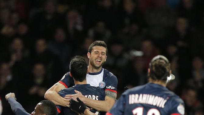 Paris Saint Germain's Thiago Motta of Italy congratulates Paris Saint Germain's Javier Pastore of Argentina after scoring the first goal during their French League One soccer match against Monaco, in Monaco stadium, Sunday, Feb. 9 , 2014