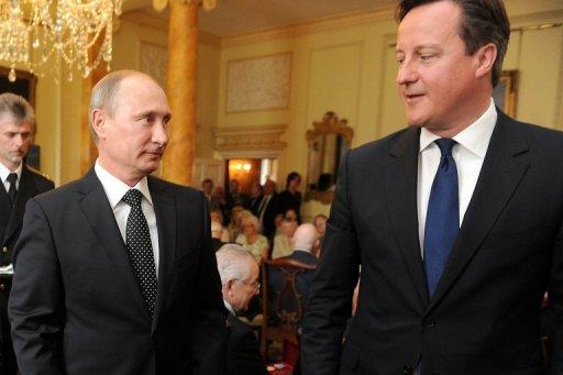 British Prime Minister David Cameron (R) and Russian President Vladimir Putin at 10 Downing Street on June 16, 2013. Cameron, the host of the meeting of top industrialised powers, insisted he could overcome his differences with Putin after they held pre-G8 talks