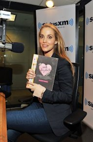 Elizabeth Berkley with her new book for teens. (Photo by Slaven Vlasic/Getty Images)