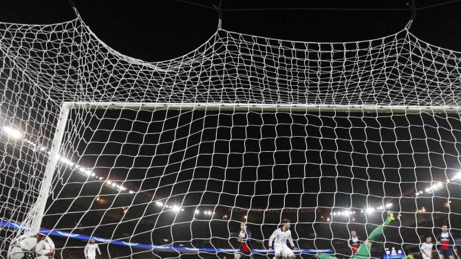 Paris St-Germain goalkeeper Sirigu fails to catch the ball as Anderlecht's de Zeeuw scored the first goal for the team during their Champions League soccer match at the Parc des Princes Stadium in Paris