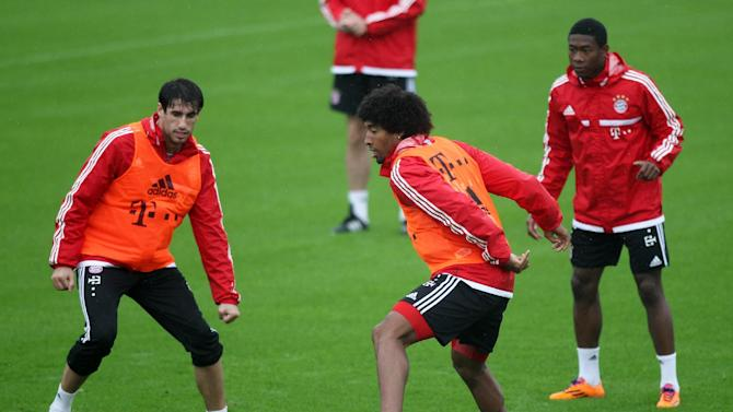 Bayern Munich players exercise during a training session at the ASPIRE Academy for Sports Excellence in Doha, Qatar, Saturday, Jan. 11, 2014