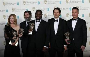 """Director McQueen celebrates with Gardner, Katagas, Kleiner and Pitt after winning Best Film for """"12 Years a Slave"""" at the BAFTA awards ceremony in London"""