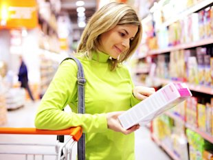 woman reading a food label