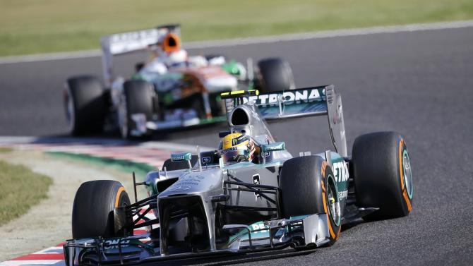 Mercedes Formula One driver Hamilton of Britain, followed by Force India Formula One driver di Resta of Britain, drives during qualifying session of the Japanese F1 Grand Prix at the Suzuka circuit