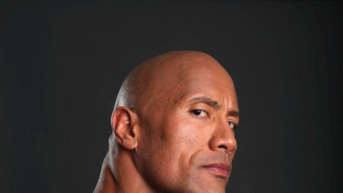 "In this Saturday, March 23, 2013 photo, Dwayne Johnson poses for a portrait at the Four Seasons in Los Angeles. The 40-year-old actor has become a savior of stale film series, injecting new life into ""Fast Five,"" ""The Mummy Returns,"" ""Journey 2: The Mysterious Island"" and now ""G.I. Joe: Retaliation."" The former professional wrestler rocks bourgeoning and established franchises by joining them on the second or subsequent installment and boosting the property's box office. (Photo by Eric Charbonneau/Invision/AP)"
