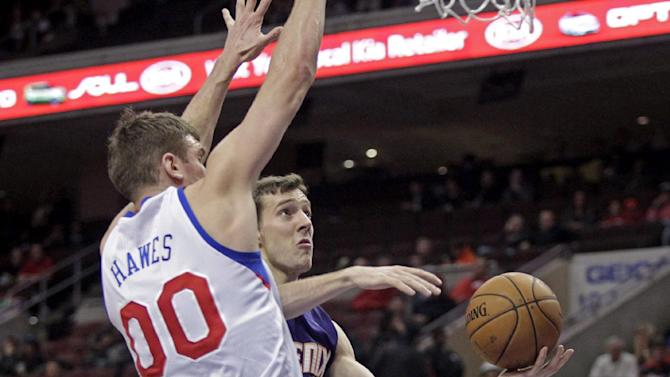 Phoenix Suns' Goran Dragic, left goes up for a shot as Philadelphia 76ers' Spencer Hawes (00) defends in the first half of an NBA basketball game, Monday, Jan. 27, 2014 in Philadelphia