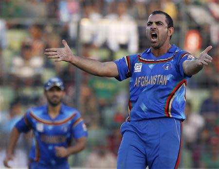 Afghanistan's Shenwari appeals for Bangladesh's Iqbal's dismissal successfully during ICC Twenty20 World Cup match Dhaka