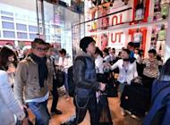 Shoppers visit Uniqlo's new store in Tokyo in March. Opponents of Japan's planned increase in sales tax from 5% to 10% say any increase in household bills would derail Japan's uncertain economic recovery