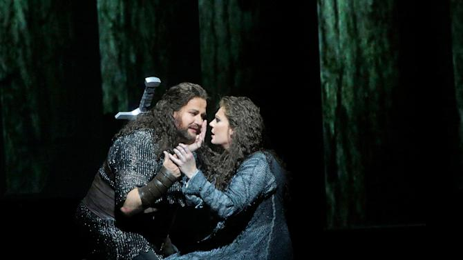 """This April 28, 2012 photo provided by the Metropolitan Opera shows Frank Van Aken as Siegmund and Eva-Maria Westbroek as Sieglinde during their performance in Wagner's """"Die Walkure,"""" at the Metropolitan Opera in New York. On May 12 the Met concludes the last of three complete presentations of Robert Lepage's production of the four-opera Ring Cycle, which includes Das Rheingold; Die Walkure; Siegfried and Gotterdammerung. (AP Photo/The Metropolitan Opera, Ken Howard)"""
