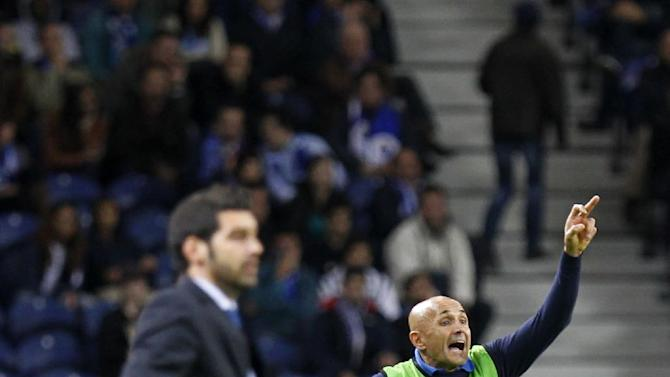 Zenit's coach Luciano Spalletti, right, from Italy, shouts instructions as Porto's coach Paulo Fonseca, left, watches the action during the Champions League group G soccer match between FC Porto and Zenit at the Dragao stadium in Porto, northern Portugal, Tuesday, Oct. 22, 2013. Zenit won 1-0