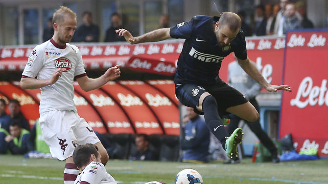 Inter Milan forward Rodrigo Palacio, top right, of Argentina, is tackled by Torino defender Marko Vesovic, bottom, of Montenegro, as Torino midfielder Migjen Basha, of Switzerland, looks them during the Serie A soccer match between Inter Milan and Torino at the San Siro stadium in Milan, Italy, Sunday, March 9, 2014