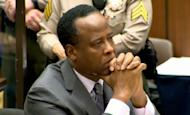 In this frame grab made from pool video, Dr. Conrad Murray listens as Judge Michael Pastor sentences him to the maximum four years in county jail for his involuntary manslaughter conviction of pop star Michael Jackson, Tuesday, Nov. 29, 2011 on Superior Court in Los Angeles. (AP Photo/Pool, CNN)