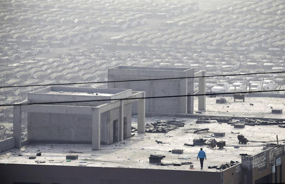 A man works on the roof of a building near the site of the explosions at Binhai new district in Tianjin