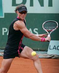 "US Open champion Samantha Stosur (pictured on June 1) is another who, like Sharapova, prefers Facebook to Twitter and her disdain for the latter was not helped on Friday when she was told that there was a Twitter account dedicated to her biceps. ""I didn't know that. That's a little bit disturbing, I think,"" the muscular Australian said"