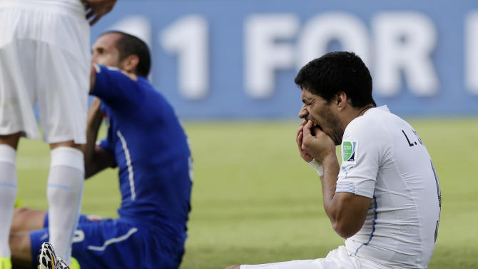 Uruguay defends Suarez as FIFA scrambles