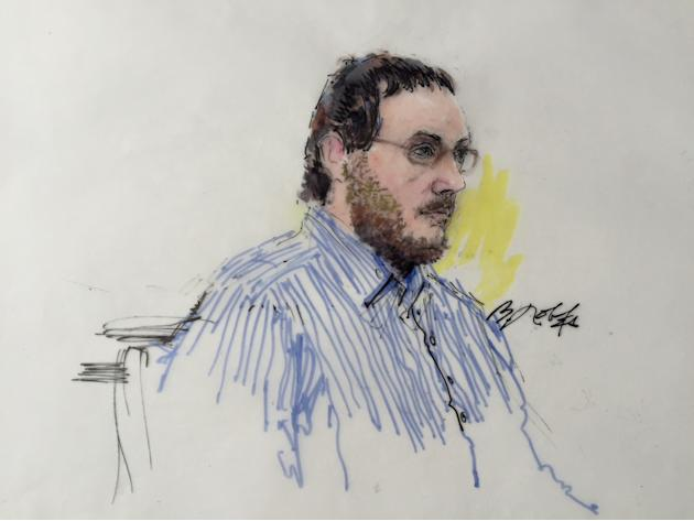 James Holmes sits in Arapahoe County District Court in Denver