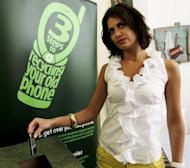 A Lebanese woman throws her mobile phone into a box for recycling during the launch of a campaign organised by Nokia in Beirut in 2010. More than a billion mobile phones are made every year but fewer than one percent are recycled, experts say, noting that billions of dollars could be saved if consumers go green
