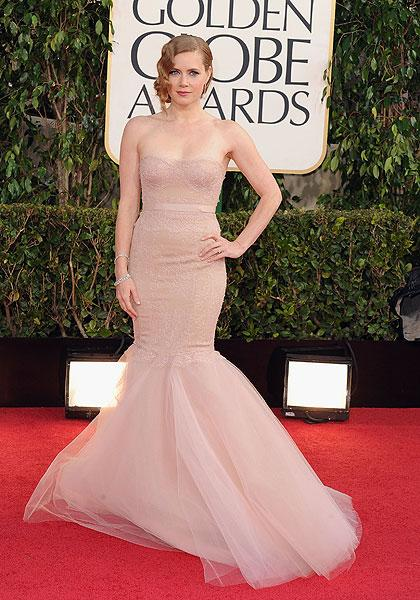 Amy Adams: 'The Master' star and Golden Globe nominee looks as if she could disappear in her nude-colour Marchesa gown. If it were any other colour, say emerald green or a deep blue, it would look spectacular, however the colour just blends in with her skin, washing out her beautiful features. (Photo by Steve Granitz/WireImage)