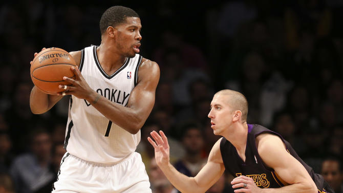 Brooklyn Nets shooting guard Joe Johnson (7) looks to pass against Los Angeles Lakers point guard Steve Blake (5) in the second half of an NBA basketball game at the Barclays Center, Wednesday, Nov. 27, 2013, in New York. The Lakers defeated the Nets 99-94