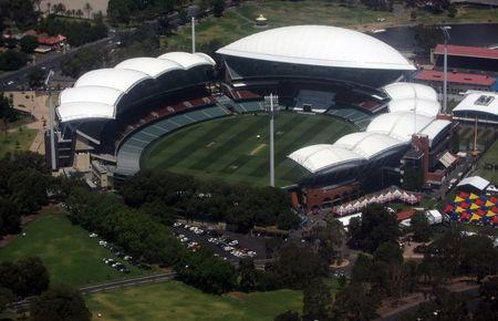 The cricket pitch can be seen in the middle of the Adelaide Oval in Adelaide, Australia